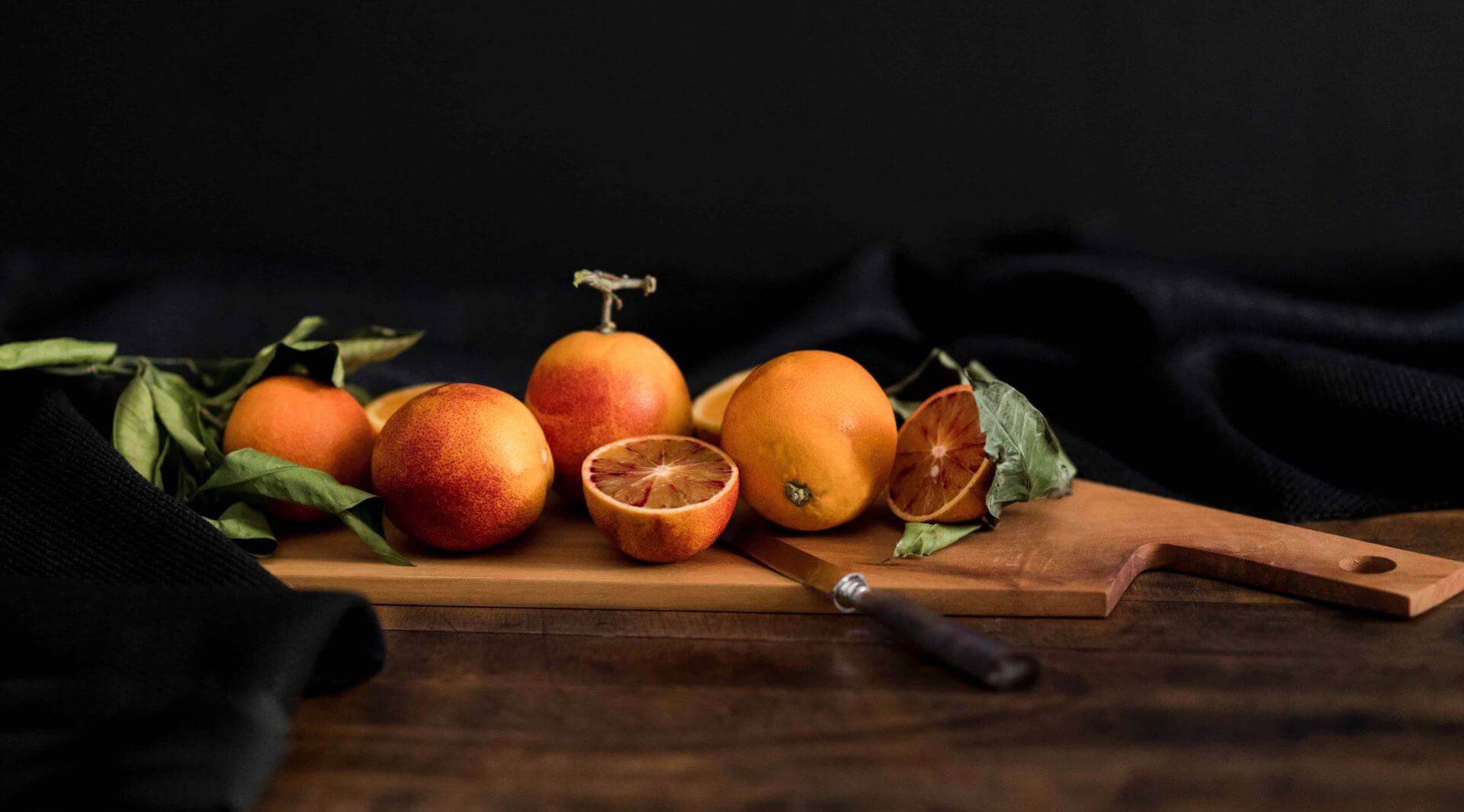 Oranges on a chopping board header image for The Food Image