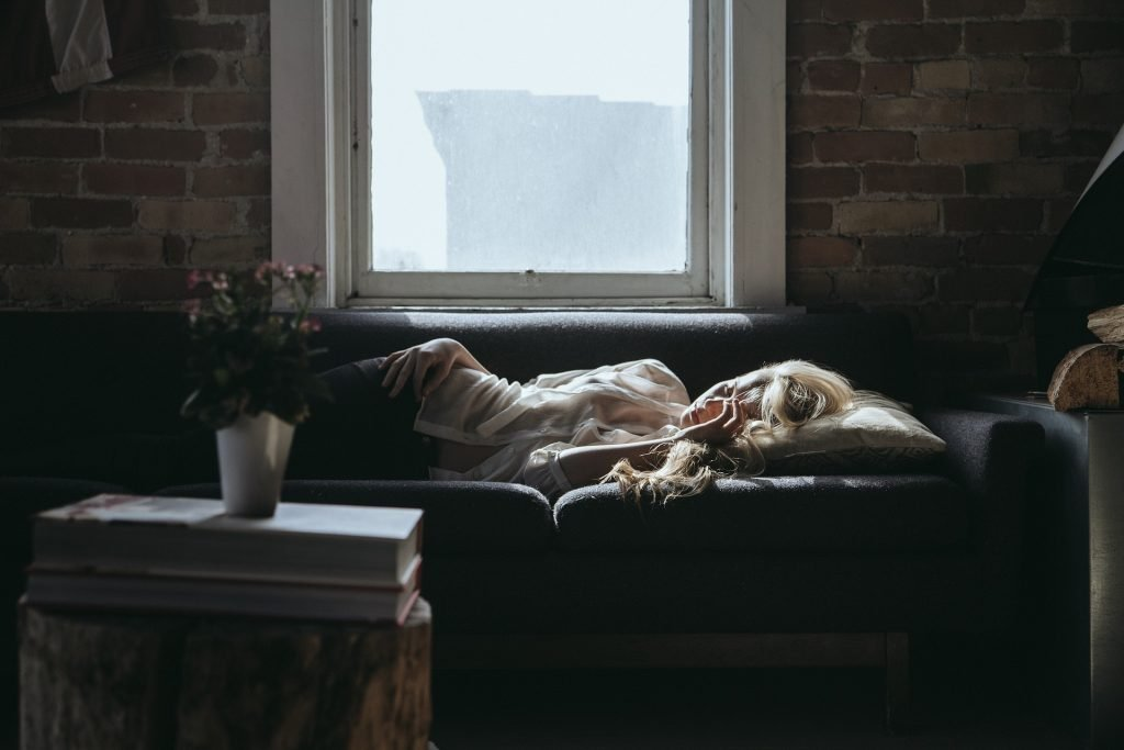 Exhausted woman taking a nap