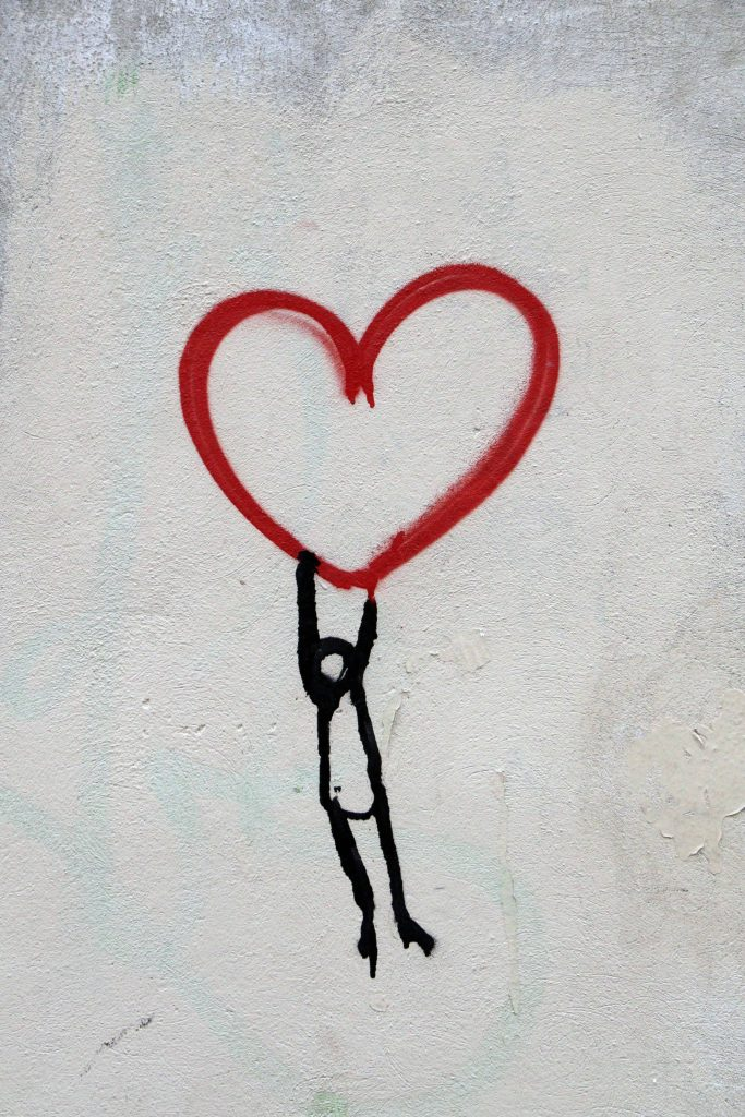 Hopeful image of person lifted up by a heart
