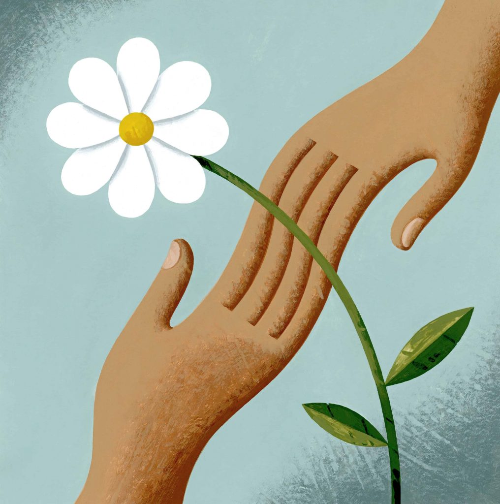 Hands joining with a peace flower